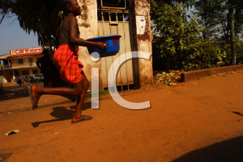 Royalty Free Photo of an African Boy Running