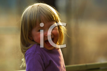 Royalty Free Photo of a Laughing Little Girl