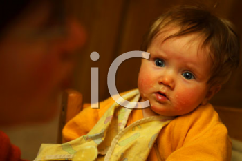 Royalty Free Photo of an Infant Being Fed
