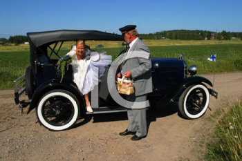 Royalty Free Photo of a Bride Getting Out of a Car