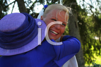 Royalty Free Photo of a Woman Hugging a Bride