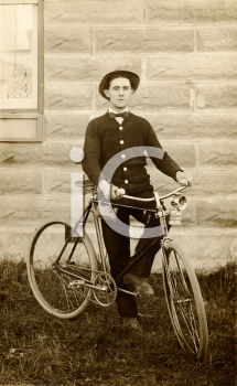 Royalty Free Photo of a Man With a Bicycle