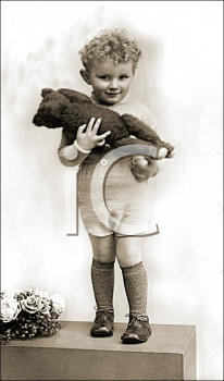 Royalty Free Photo of a Child Holding a Teddy Bear