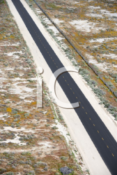 Royalty Free Photo of an Aerial of a Two Lane Highway Through a Desolate Landscape