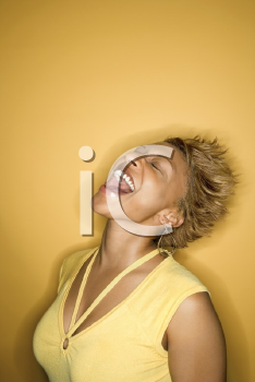 Royalty Free Photo of a Portrait of a Young Woman Laughing With Head Back