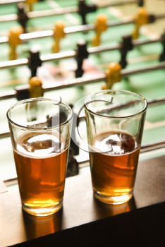 Royalty Free Photo of Two Glasses of Beer on a Foosball Table