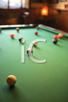 Royalty Free Photo of a Green Billiards Table With Pool Balls Spread Out