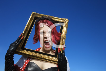 Royalty Free Photo of a Woman Holding an Empty Frame Around Her Head