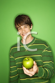 Royalty Free Photo of a Teen Boy Holding an Apple