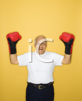 Royalty Free Photo of an Older Man Wearing Boxing Gloves