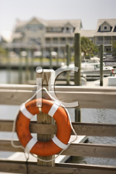 Royalty Free Photo of a Life Preserver Hanging on a Dock in Bald Head Island, North Carolina