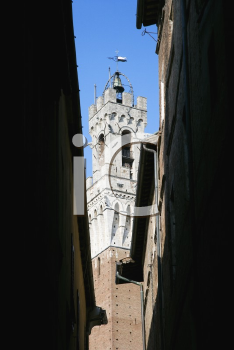 Royalty Free Photo of Torre del Mangia Bell Tower Seen Through a Darkened Alleyway