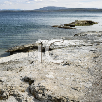 Royalty Free Photo of a Rocky Shoreline at Yellowstone National Park, Wyoming