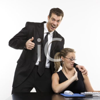 Royalty Free Photo of a Man Sexually Harassing a Woman Sitting at a Computer and Giving a Thumbs Up