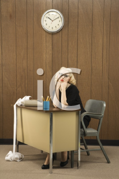 Royalty Free Photo of a Female in a Vintage Outfit Sitting at a Desk With Her Chin on Her Fists