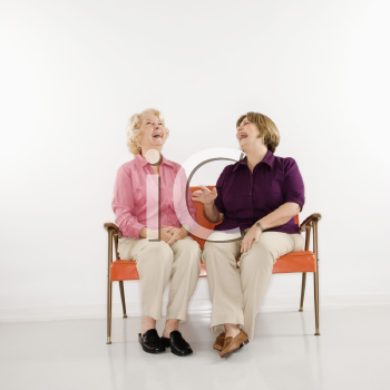Royalty Free Photo of Older Women Sitting and Laughing