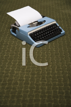 Royalty Free Photo of a Vintage Blue Typewriter