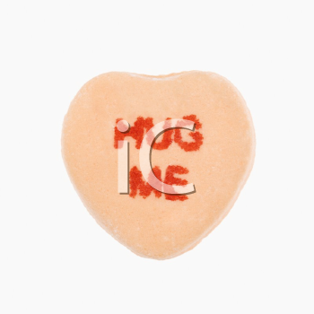 Royalty Free Photo of an Orange Candy Heart That Reads Hug Me