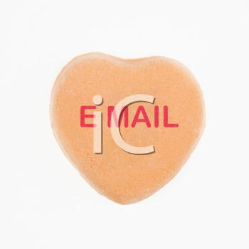 Royalty Free Photo of an Orange Candy Heart That Reads Email