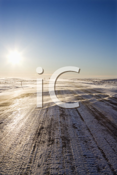 Royalty Free Photo of an Ice Covered Road with Tire Marks