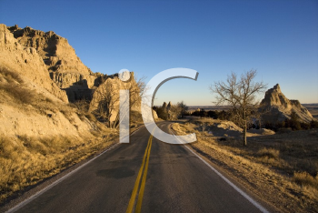 Royalty Free Photo of a Scenic Roadway in Badlands National Park, South Dakota
