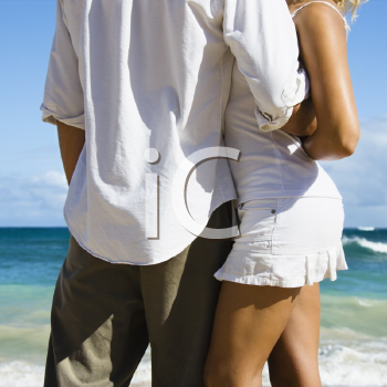 Royalty Free Photo of an Attractive Couple in an Embrace on Maui, Hawaii Beach