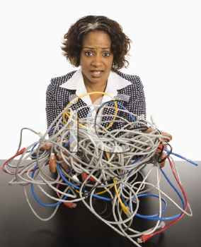 Royalty Free Photo of a Businesswoman Holding a Bundle of Tangled Computer Cords