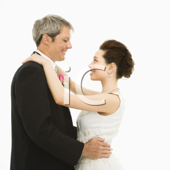 Royalty Free Photo of a Bride and Groom Dancing