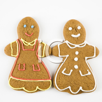Two female gingerbread cookies holding hands.