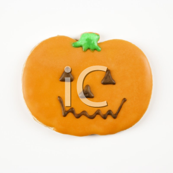 Sugar cookie in shape of jack o lantern with decorative icing.