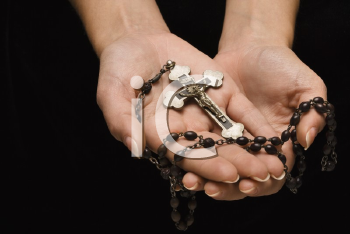 Royalty Free Photo of Woman's Hands Palm Up Holding a Rosary With a Crucifix