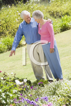 Royalty Free Photo of a Senior Couple in a Flower Garden