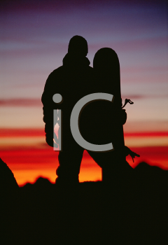 Royalty Free Photo of a Silhouetted Snowboarder at Dusk