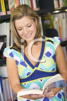 Royalty Free Photo of a Woman Reading a Book