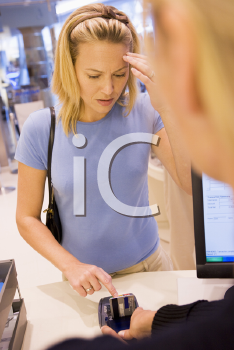 Royalty Free Photo of a Woman Trying to Remember Her PIN Number
