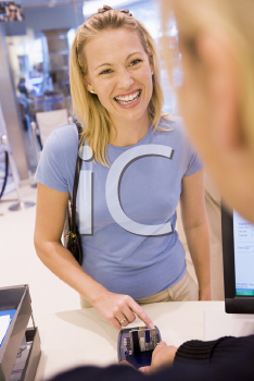 Royalty Free Photo of a Woman Paying For Purchases