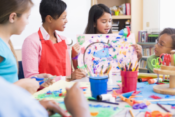 Royalty Free Photo of a Teacher and Students in Art Class