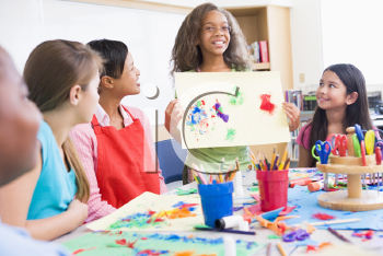 Royalty Free Photo of a Student Showing Her Art in Class