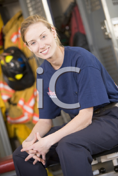 Royalty Free Photo of a Female Firefighter Sitting in the Locker Room