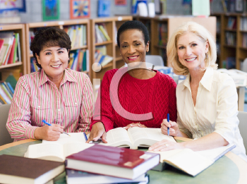 Royalty Free Photo of Three Women in a Library