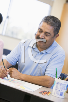Royalty Free Photo of an Adult Student Taking Notes