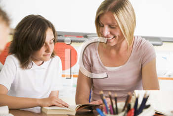 Royalty Free Photo of a Teacher and Student in Class