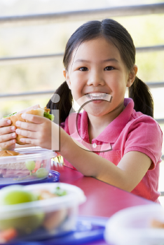 Royalty Free Photo of a Child Eating Lunch