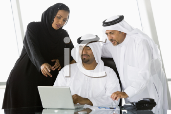 Royalty Free Photo of Two Men and a Woman Looking at a Laptop