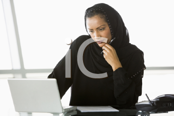 Royalty Free Photo of a Woman With a Laptop