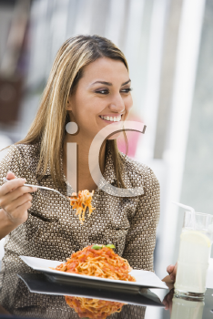 Royalty Free Photo of a Woman Eating Spaghetti