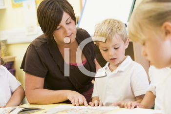 Royalty Free Photo of Students and a Teacher Reading