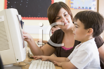Royalty Free Photo of a Teacher and a Computer Class