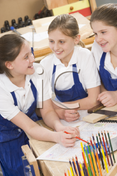 Royalty Free Photo of Girls in a Woodworking Class