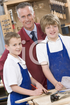 Royalty Free Photo of a Teacher With Woodworking Students
